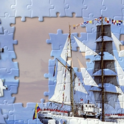 Jigsaw World - Jigsaw World comes packed with hours of easy breezy puzzle fun! Choose puzzles from six beautiful themes and use your mouse to play. - logo